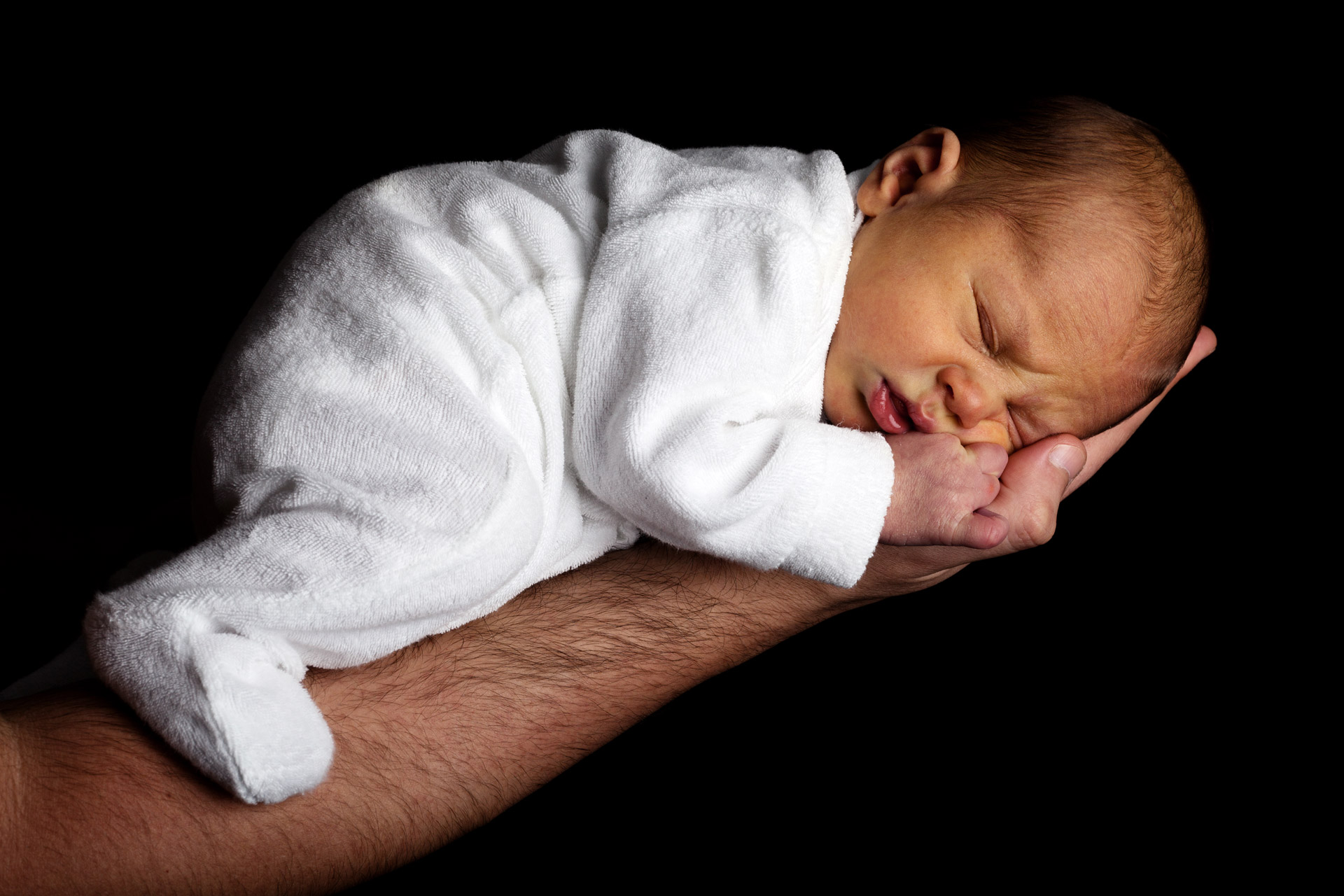 Newborn Baby On An Arm